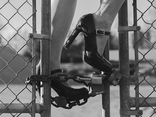 shoes on chain link