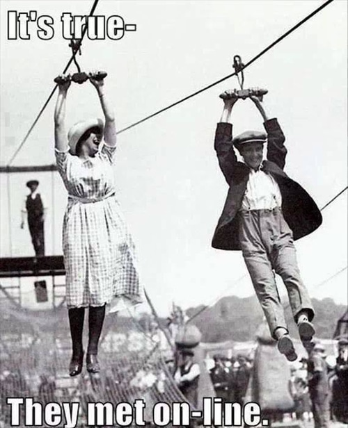 old fashioned picture of man and woman on a zip line