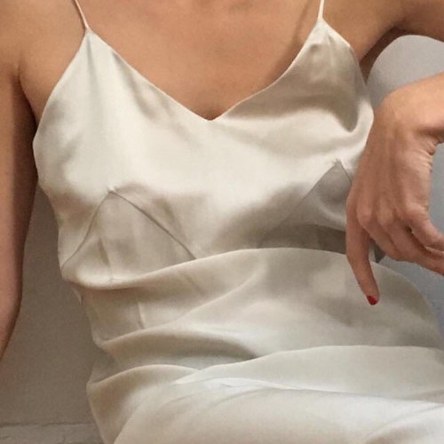 Woman in satin slip with no rings