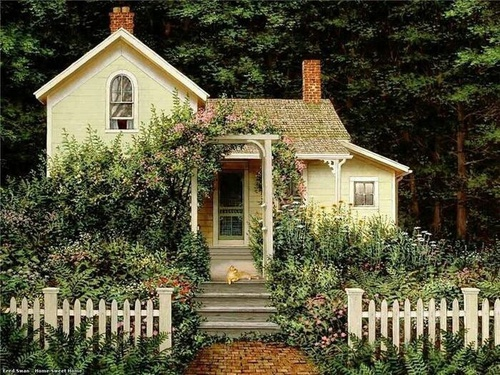 Yellow house with picket fence, cat and roses on vines