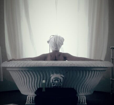 Woman in tub considering her life after divorce