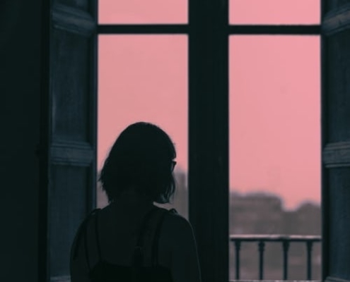 A woman starting out the window thinking of divorce facts